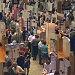 Science fair with a room full of projects mounted on  tri-fold display boards