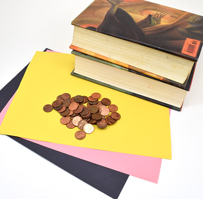 Paper, pennies and two large textbooks