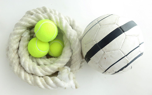 A rope, three tennis balls and a soccer ball
