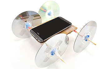 car with CD wheels and phone with Google's science journal measuring acceleration