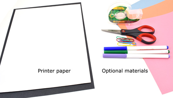 Printer paper, markers, scissors, tape, paperclips and colored construction paper