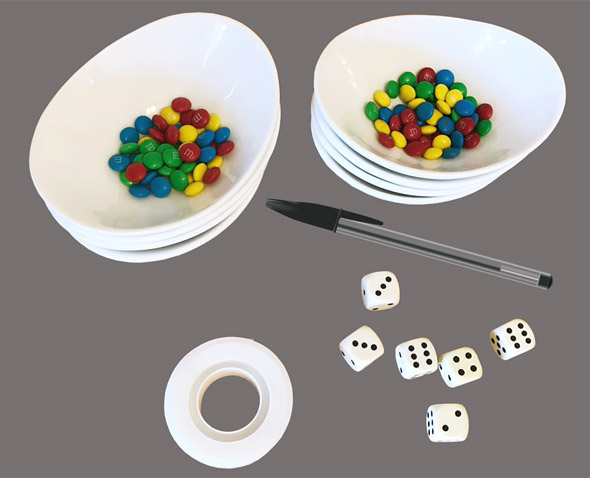 Materials needed for the autoimmune activity which include six six-sided dice and m&m candies