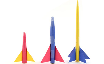 three different size paper rockets
