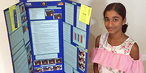 Student success story - student with project display board