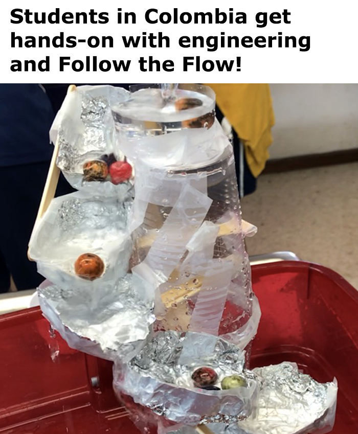 A terraced waterfall made from plastic cups, aluminum foil, popsicle sticks and tape