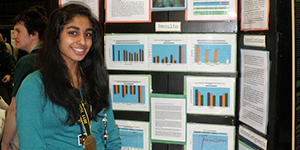 Image of student with biofuel project display board