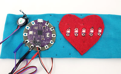 an Arduino Uno connected to a pulse sensor and an LED on a breadboard