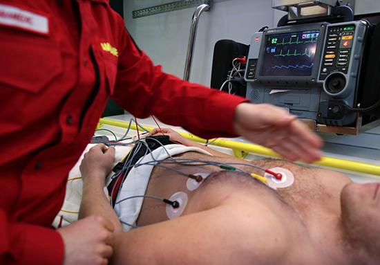 EKG machine hooked up to man in ambulance