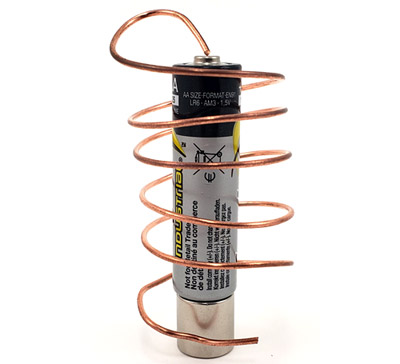 AA battery on top of a cylindrical neodymium magnet, with a copper wire wrapped around it in a spiral.