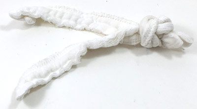 Two cotton strips knotted together at one end.