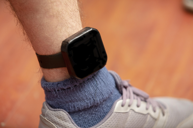 parolee wearing GPS ankle bracelet