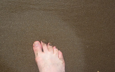 foot impression in beach sand thumbnail