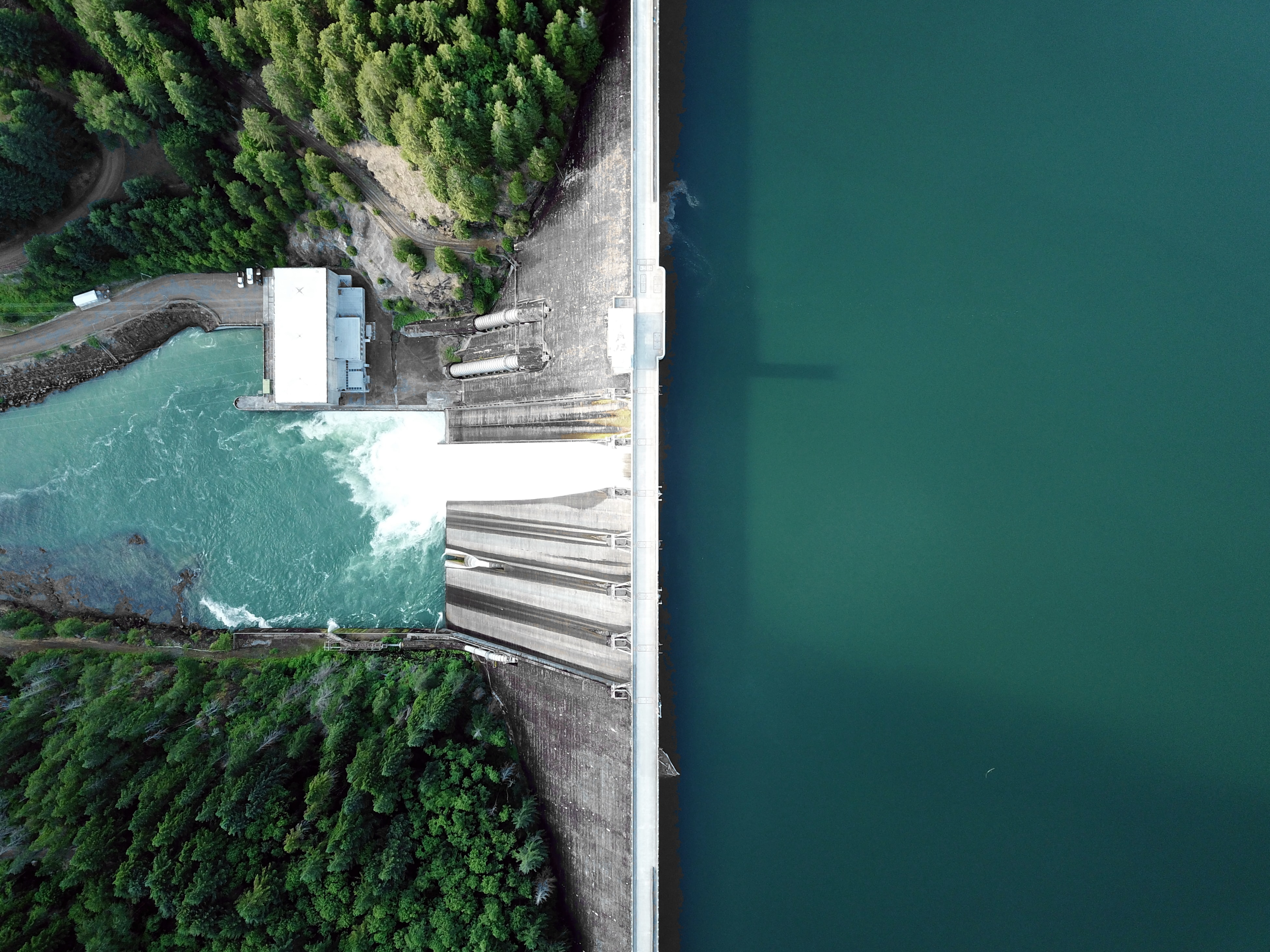 water rushing through hydroelectric plant gates