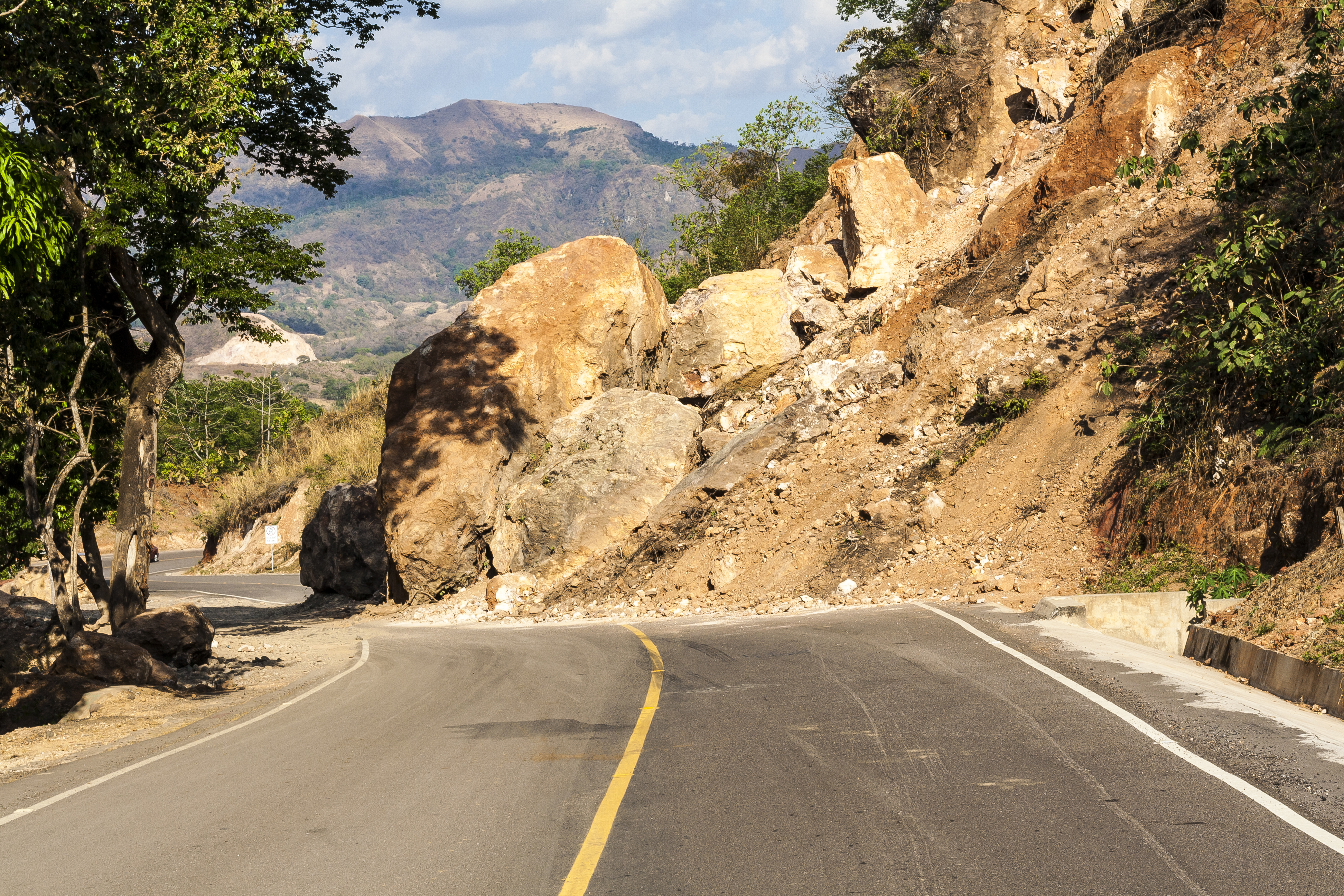road damaged by landslide