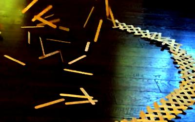 popsicle stick chain in the process of exploding.
