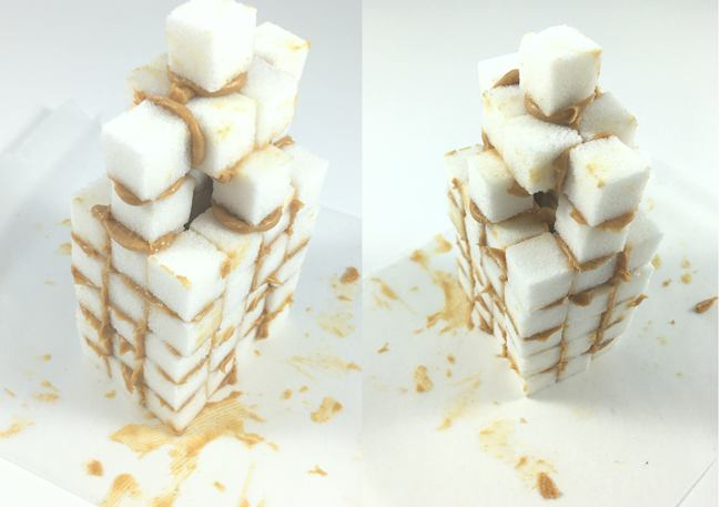 Two almost identical tall skinny buildings 8 sugar cubes high, 3 cubes wide, and 4 cubes deep.