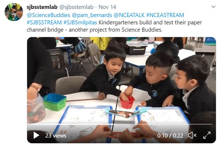 Students doing paper bridges activity