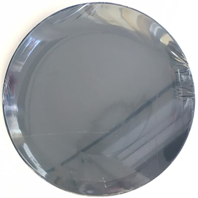 Ceramic plate with plastic wrap stretched over it.