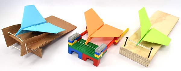 Paper airplane launchers made from different materials