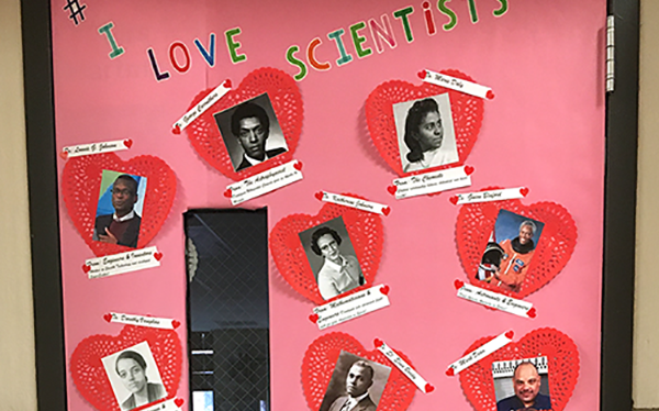 Classroom door decorated with pictures of scientists and engineers featured in Black History Month resource