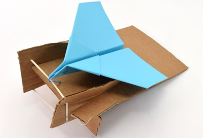 Paper airplane launcher made from cardboard and rubber band