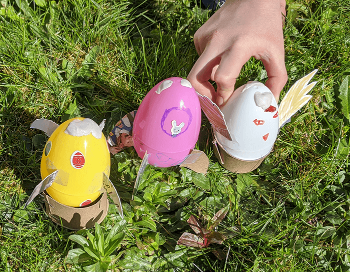 Row of three plastic Easter eggs that have been filled and set in place as rockets