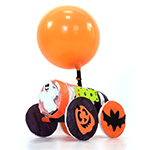 Balloon car with a halloween and batmobile theme made from a balloon, recycled cardboard tube, and craft materials