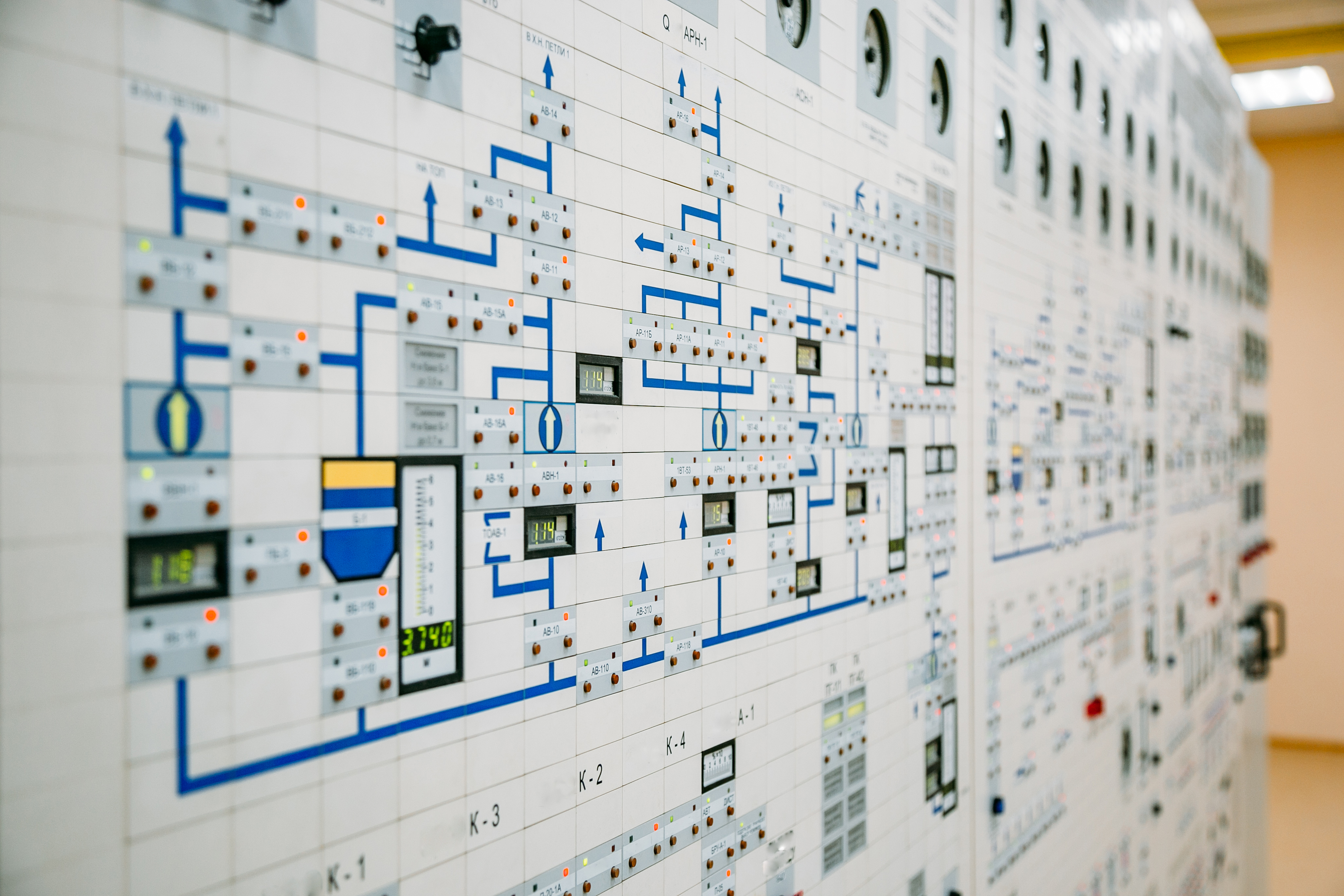 nuclear power reactor operators in front of main control pannel