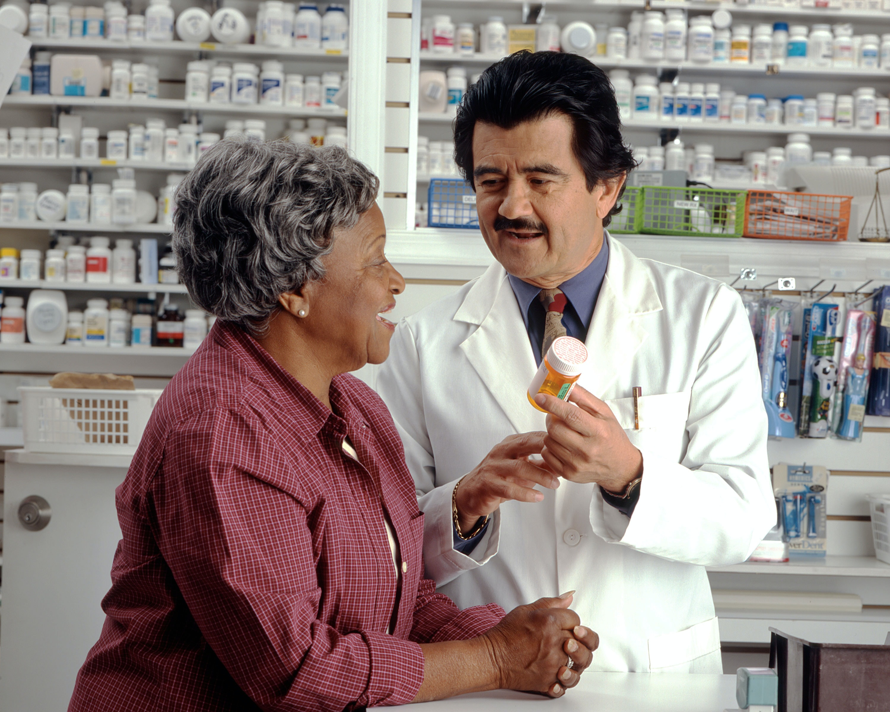pharmacist answering patients' questions