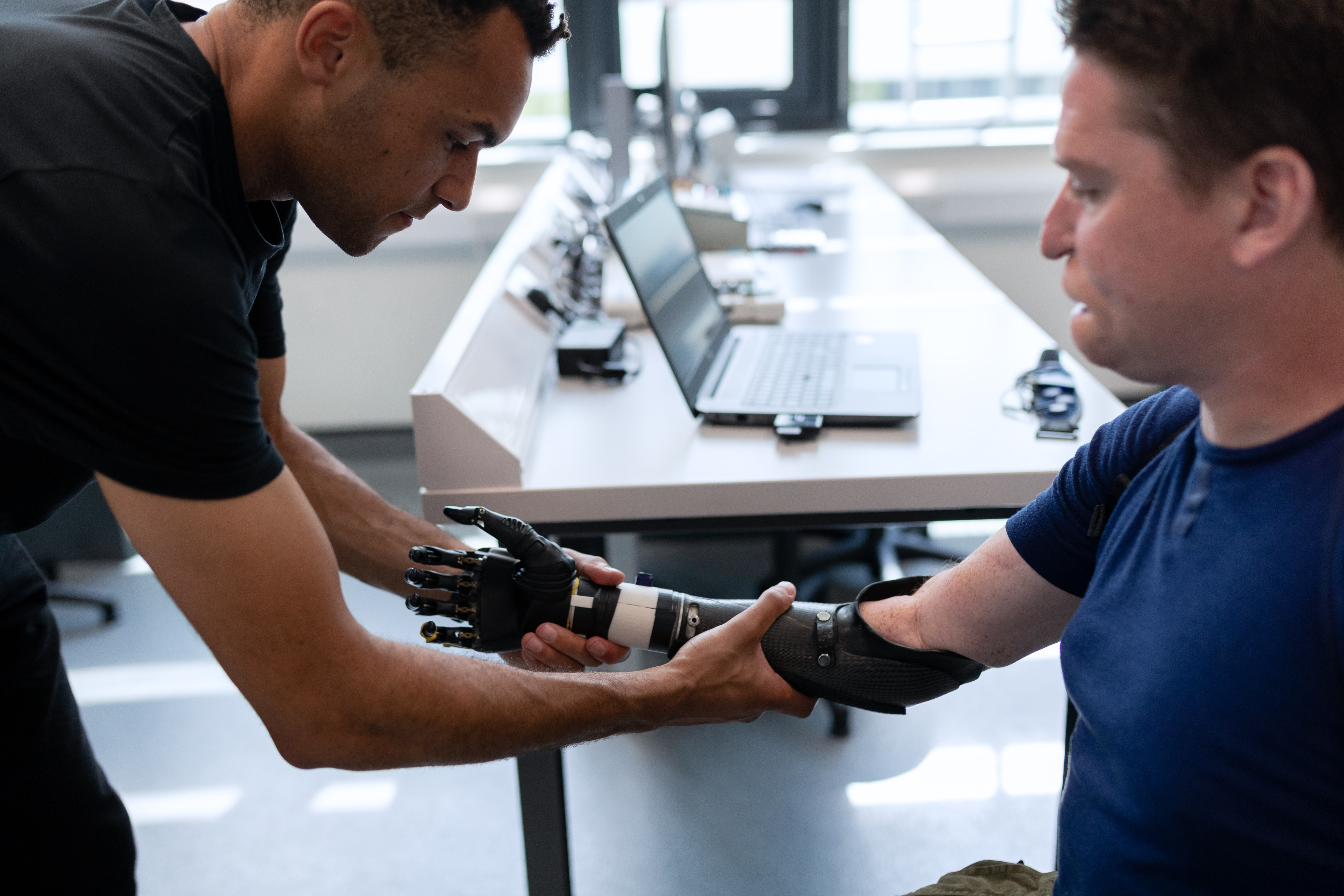 amputee being fitted with prosthetic leg