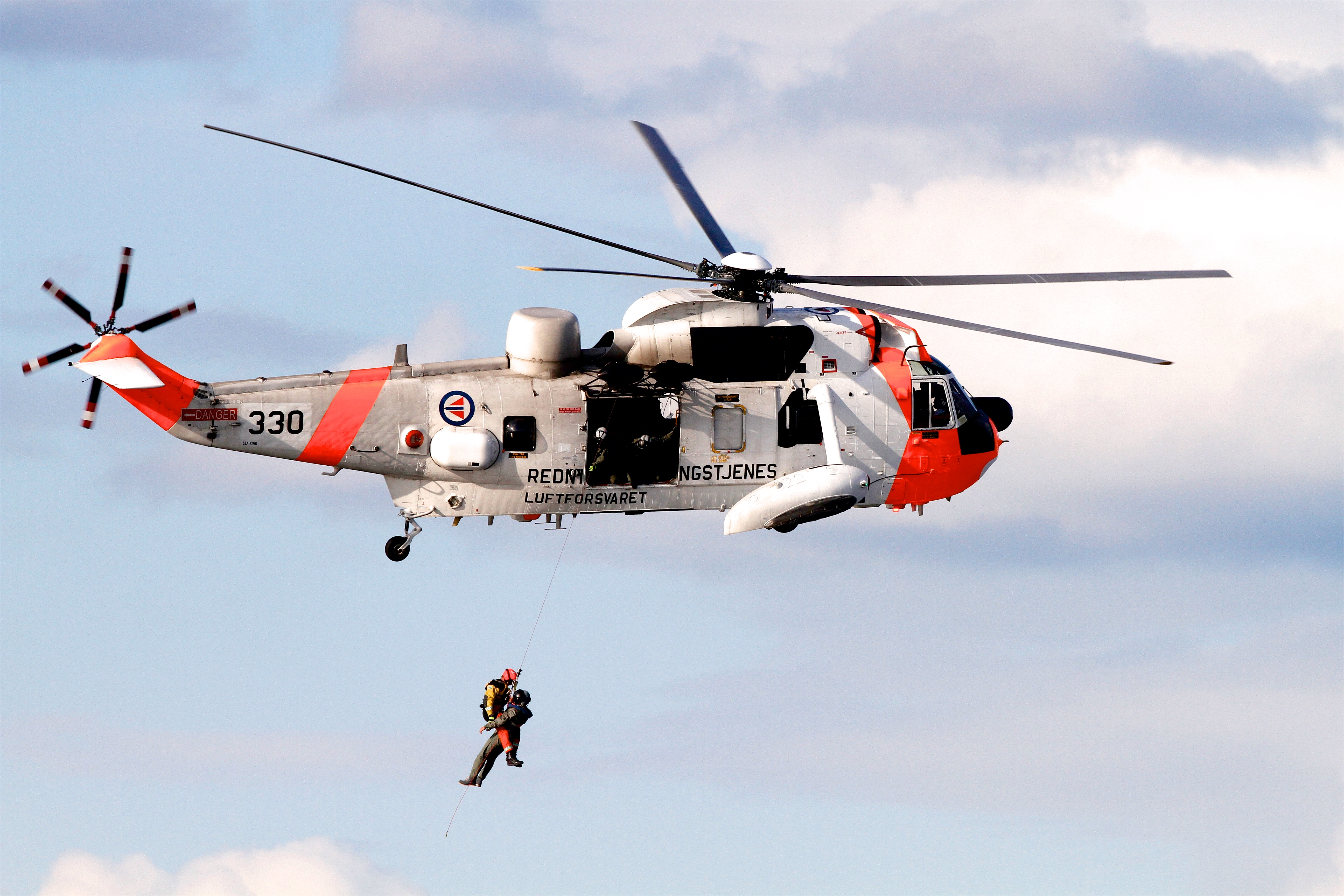 coastguard rescuing people from water by helicopter