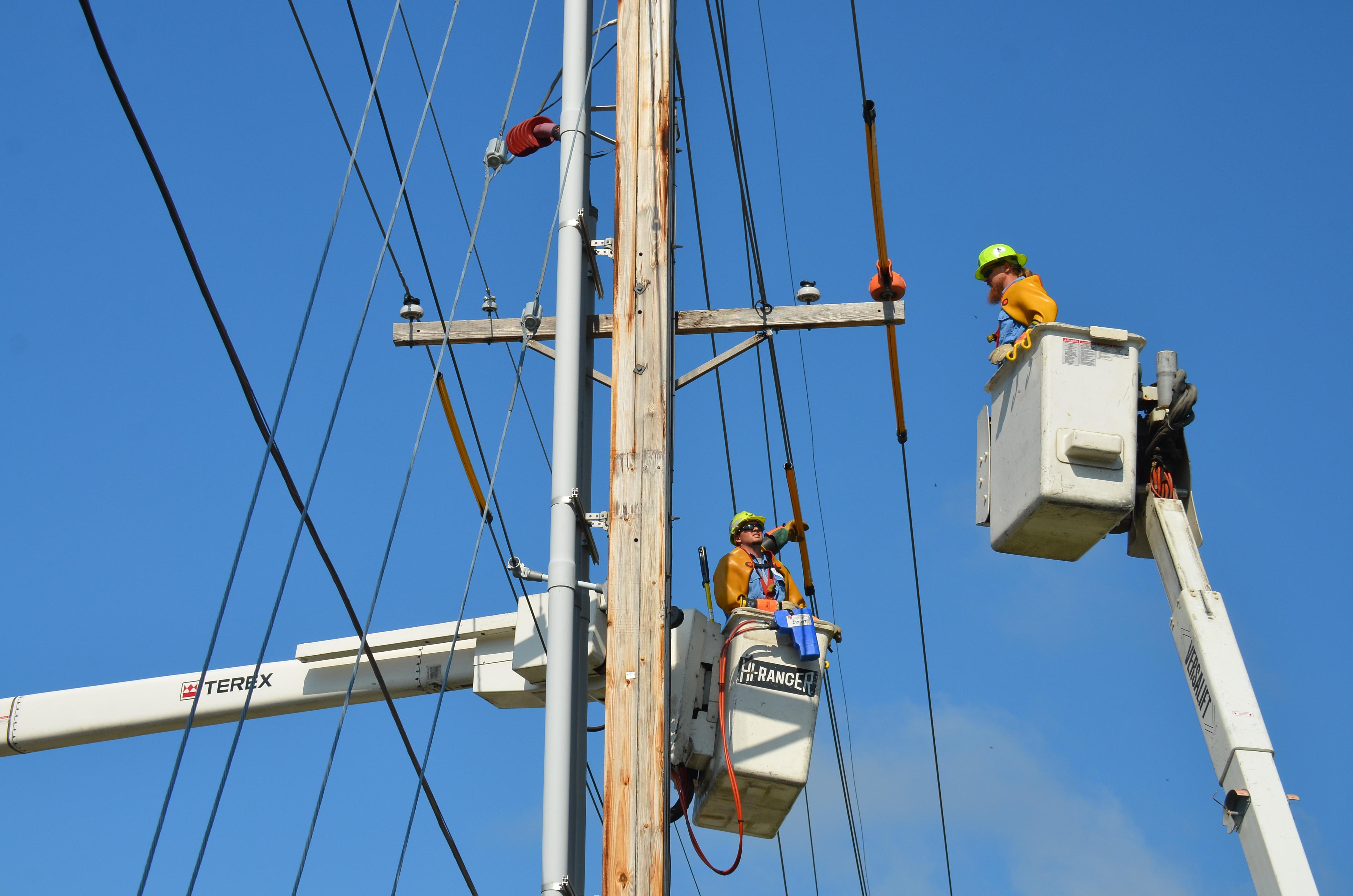 linemen repairing power lines