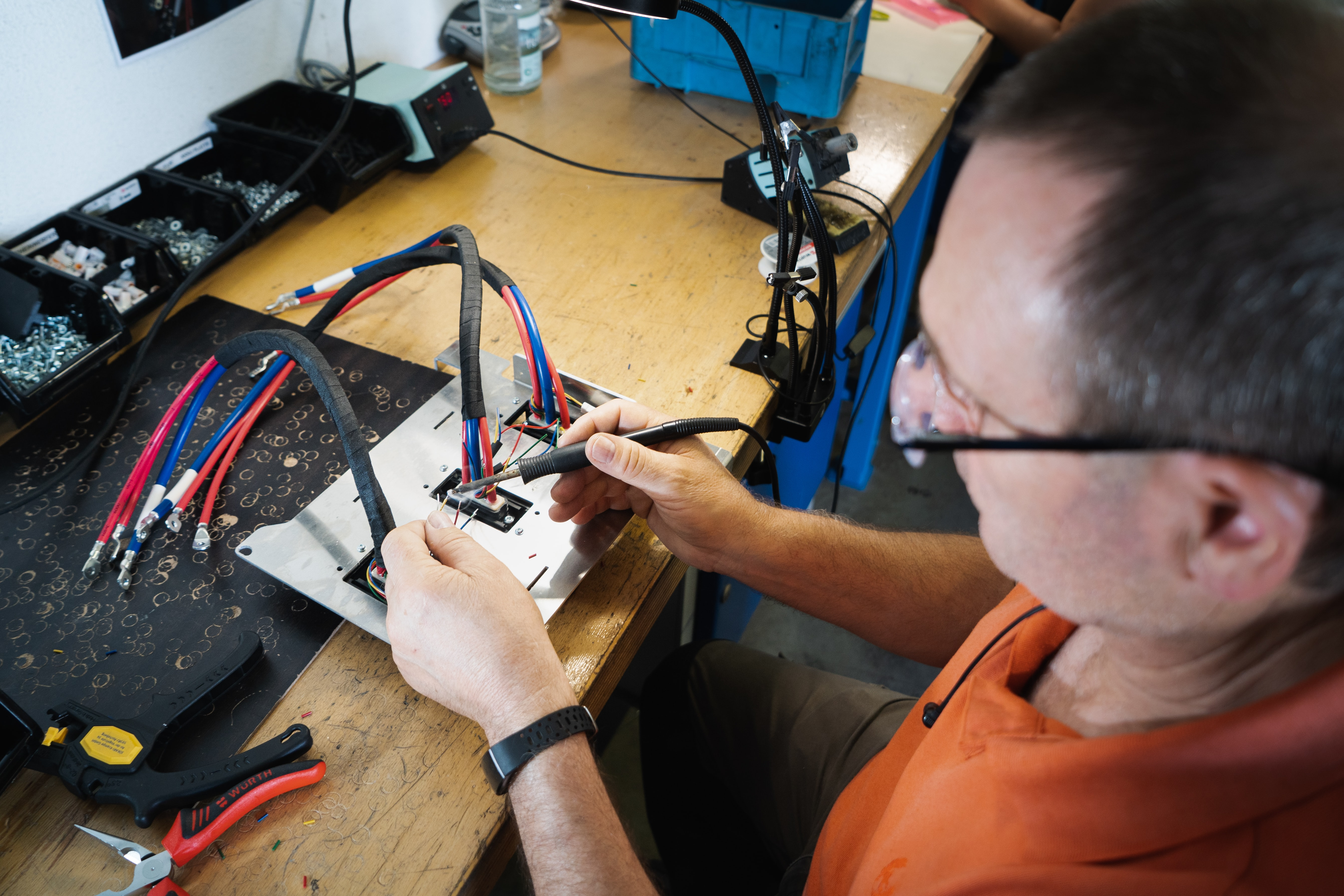 precision instrument repairman working on watch parts