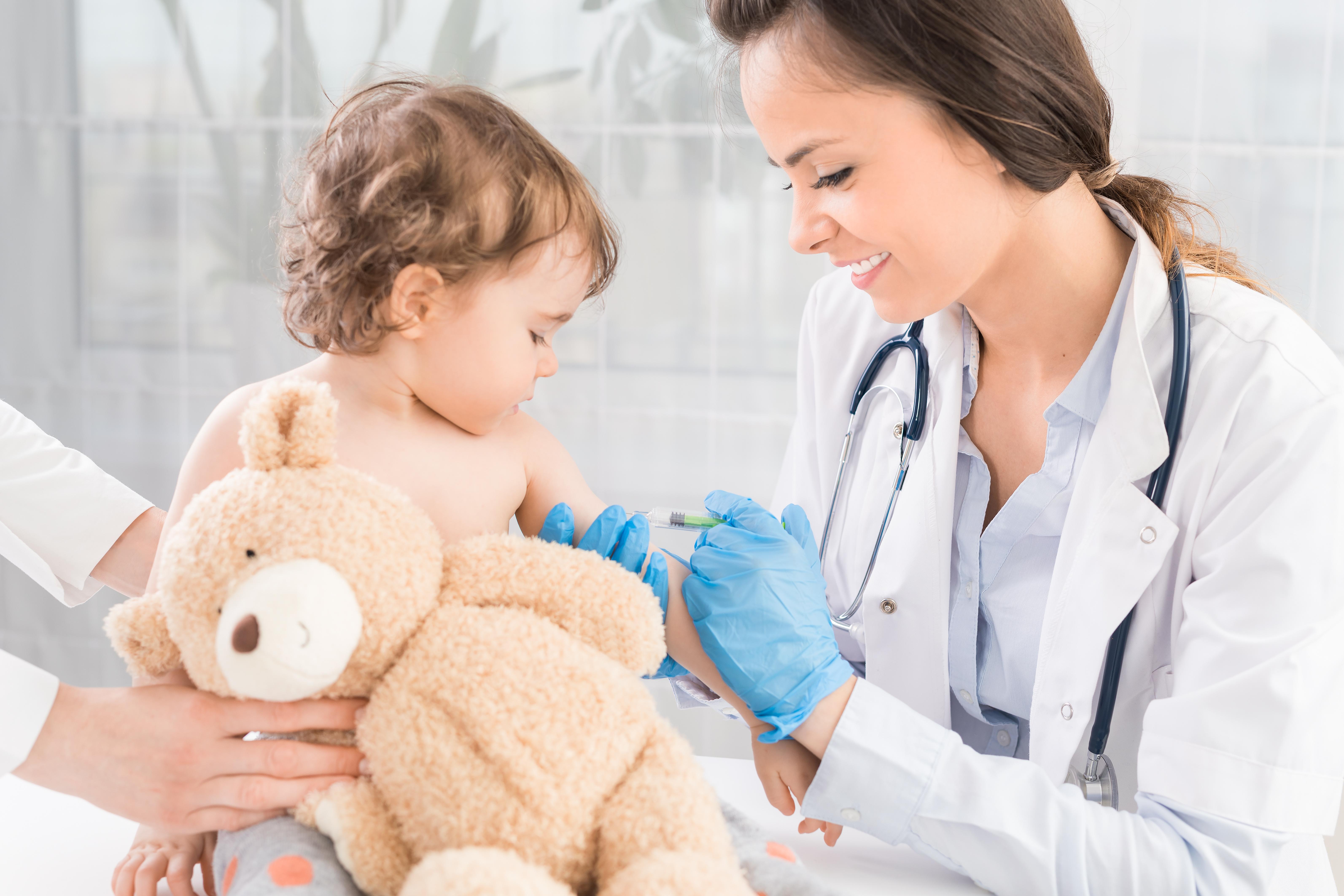 nurse vaccinating infant