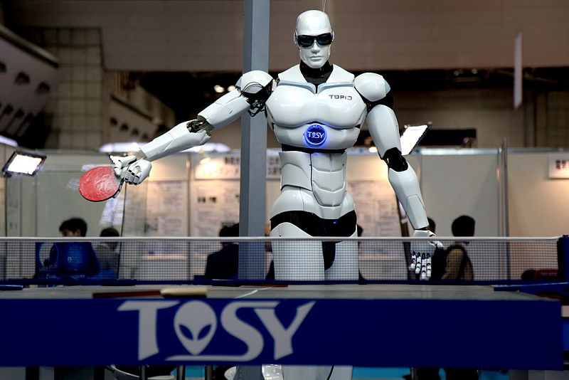 human looking robot playing ping pong