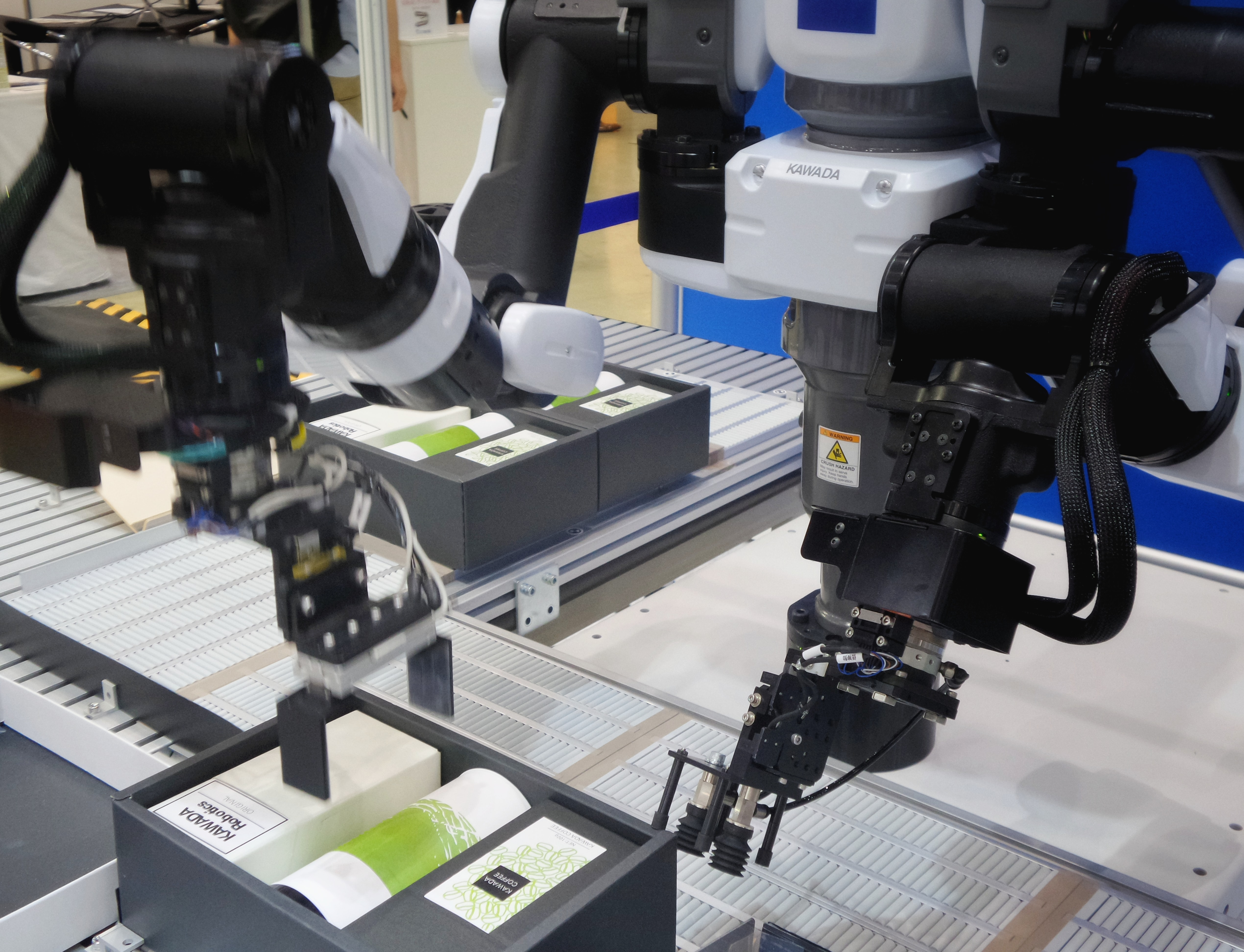 robotic arms working on car manufacturing assembly line