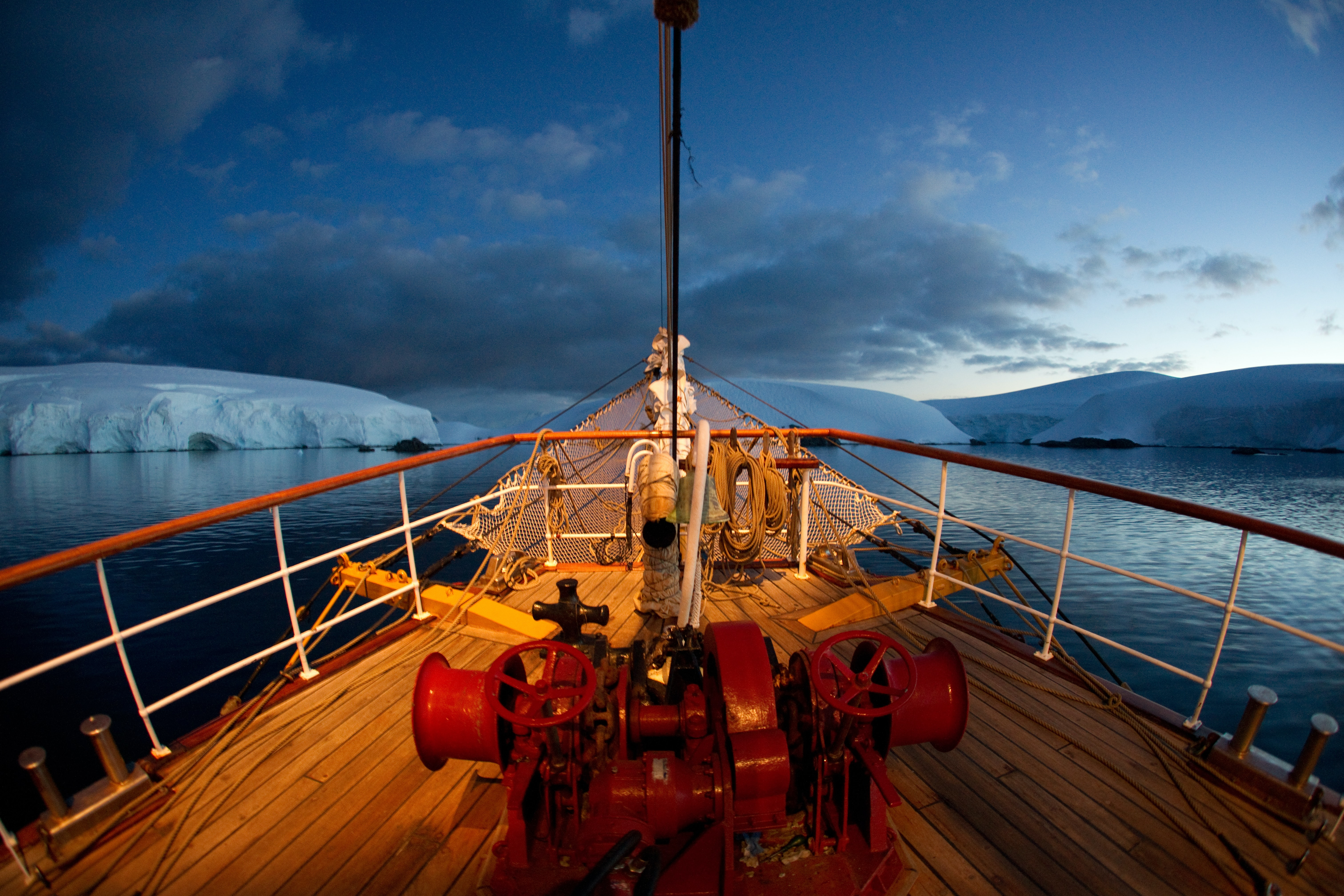 ice cutting ship and researchers in antartica