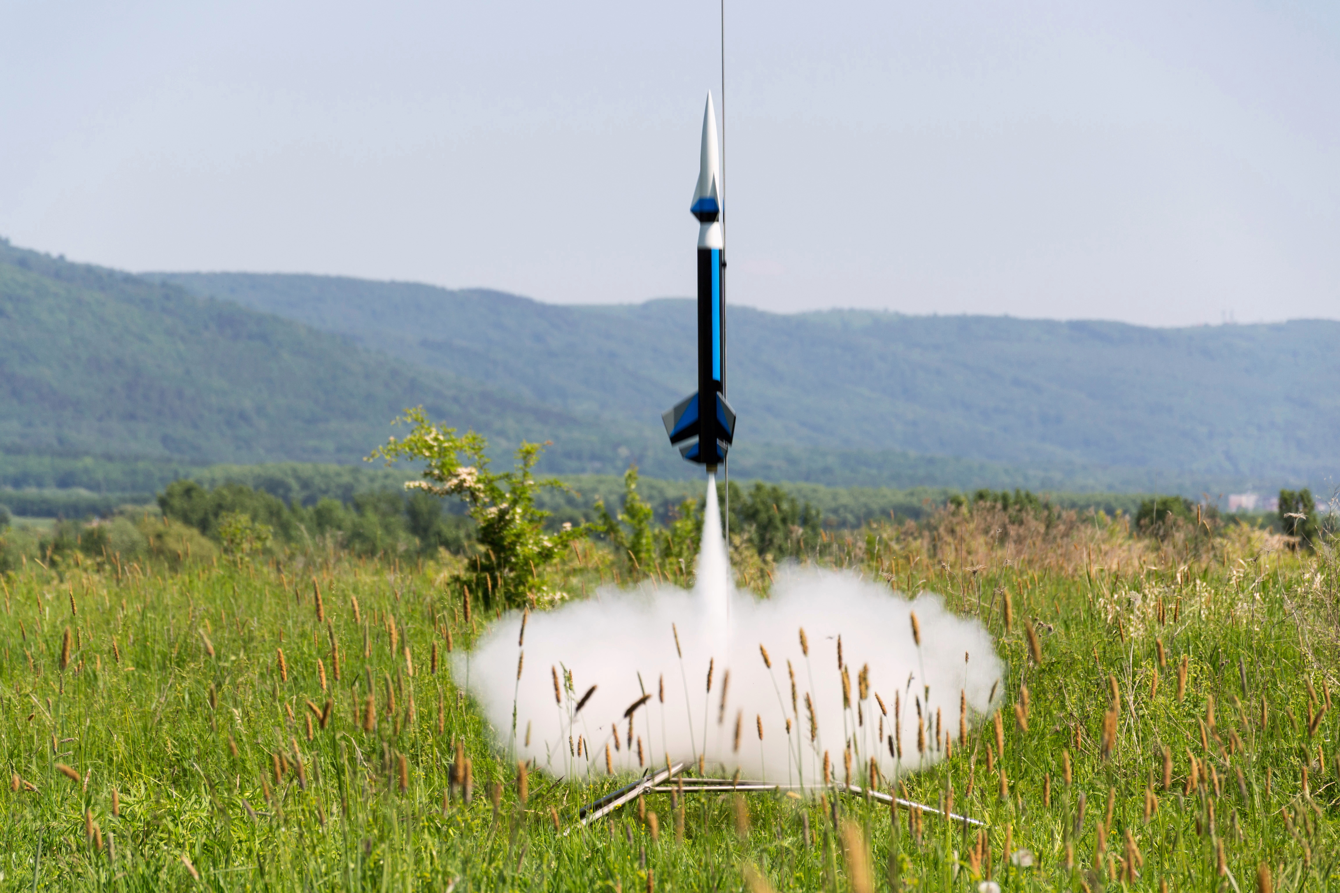 model rocket blasting off