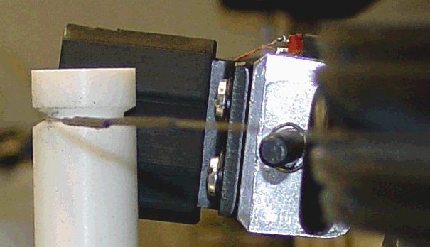 Mechanics: detail of Teflon tensioner device.  Also shows splice in heavy gauge wire.