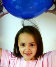 Girl with static hair and balloon