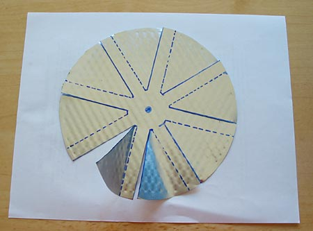 Drawing of eight flaps cut into a circle