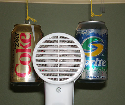 Aerodynamics Science Project aiming the hairdryer between cans