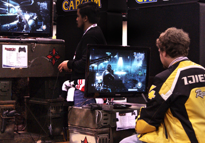 Two men play videogames side-by-side