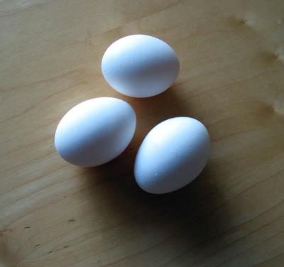 Three eggs lay on a table