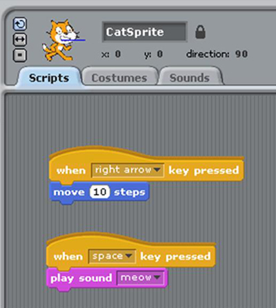 screenshot of Scratch showing a cat sprite with code for two scripts