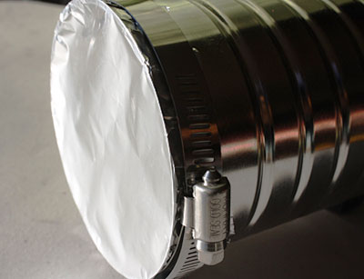 Aluminum foil stretched over a can and secured with a pipe clamp