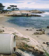 Urban runoff entering ocean in Monterey Bay from storm drain outfall