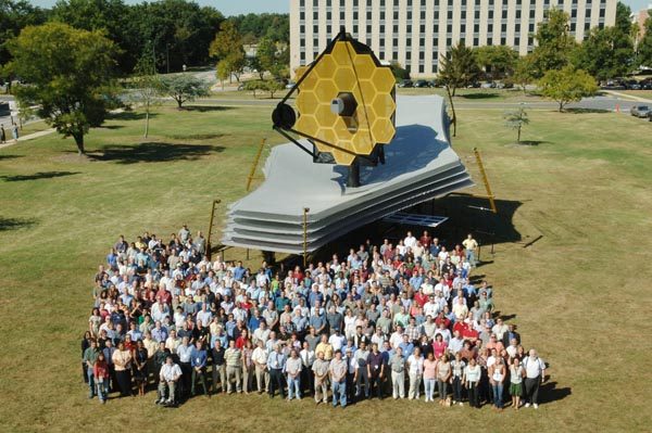 Group shot of JWST mockup with some of the development team