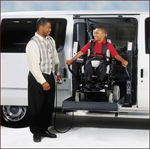 Child in a wheelchair uses a hydraulic lift to easily enter a vehicle