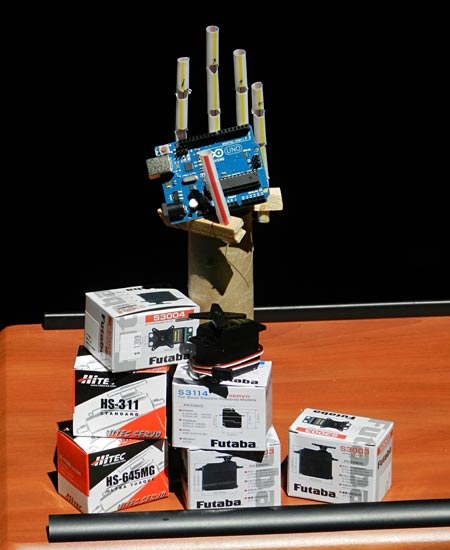 Servos, Arduino board, and robot hand built out of drinking straws. Robotics science project